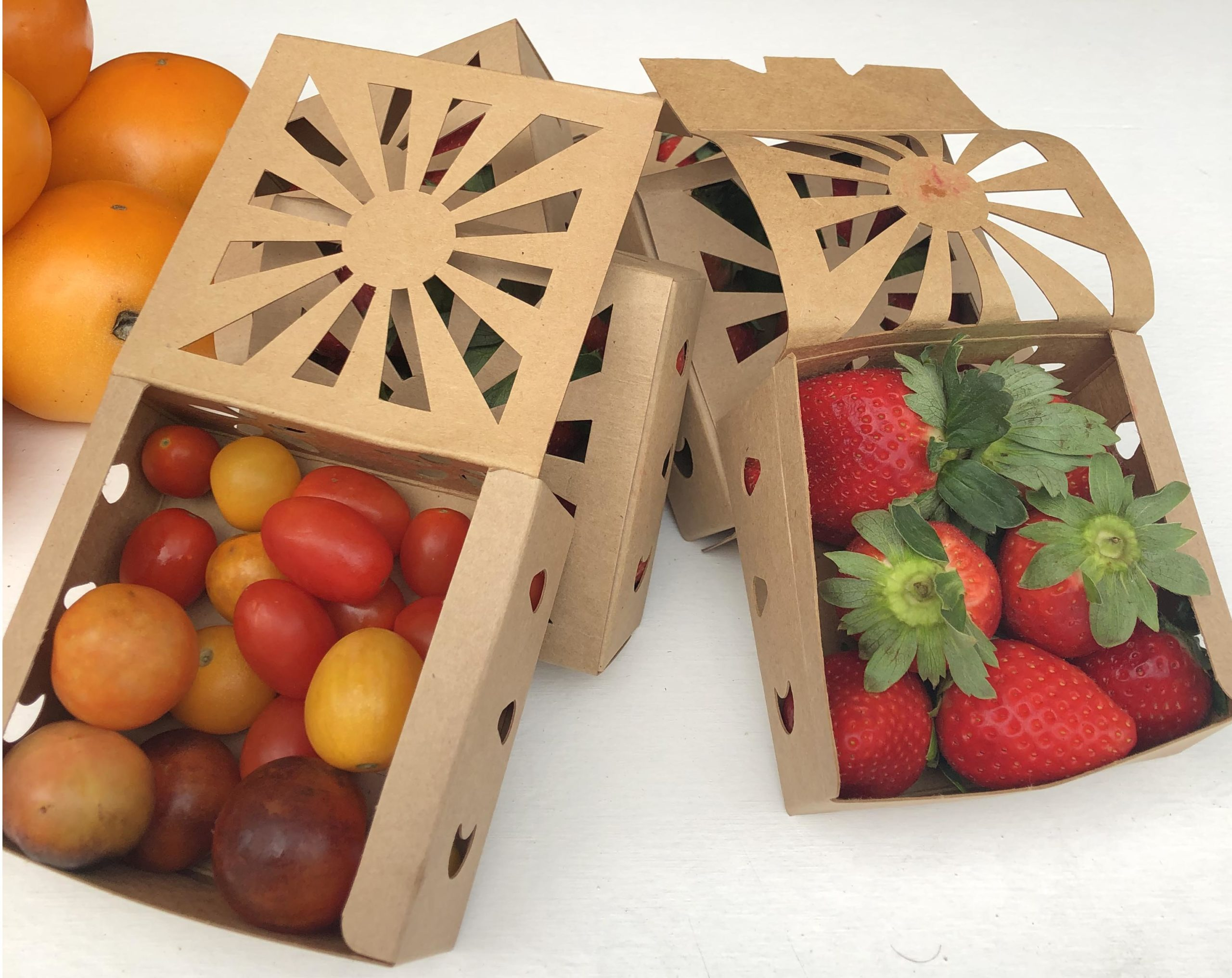 Organic strawberries and cherry tomatoes in recyclable half pint container